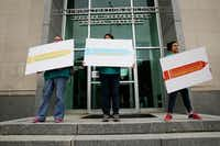Tanya Hernandez (left) rallies for a tax ratification election with her daughter, Stephanie Hernandez (center), before a public hearing and board meeting of the Dallas Independent School District at DISD headquarters in Dallas on Friday. Speakers, some part of community organizations, urged DISD trustees to vote for a tax ratification election that would raise taxes to increase the money sent to support schools. (Andy Jacobsohn/Staff Photographer)