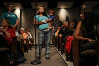 Mandy Lee-Vielma, who has three children in DISD, holds onto her fourth child, Grayson Padilla, 1, while speaking in support of a 13-cent tax ratification election during a public hearing and board meeting of the Dallas Independent School District at the Dallas ISD headquarters on Aug. 18.(Andy Jacobsohn/Staff Photographer)