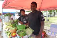 Promise of Peace Community Garden interns Noel Jones and Guillermo Martinez do a little bit of everything to help out, including booth duties at the Four Seasons Casa Linda farmers market. (Kim Pierce/Special Contributor)