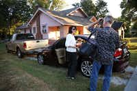 Dawn Humphrey is greeted by her husband, Jeffery Humphrey, who takes her things, as she arrives at her home in Waco after driving the more than 200-mile round trip commute from her Irving office.(Rose Baca/Staff Photographer)