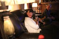 Dawn and Jeffery Humphrey relax with their dog at their Waco home.(Rose Baca/Staff Photographer)