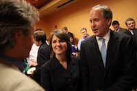 AG Ken Paxton and his wife, Angela, after he won election to the Texas Senate in 2014.(Andy Jacobsohn/Staff Photographer)