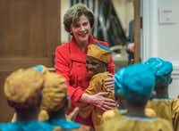 Laura Bush embraced  members of the African Children's Choir before their performance at the George W. Bush Presidential Center in December 2016. (Rex C. Curry/Special Contributor)