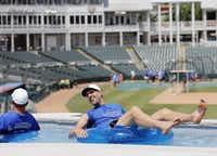 Dallas Mavericks player Dirk Nowitzki visited with Charlie McKinney, founder of the annual Heroes Celebrity Baseball Game, in the lazy river after training camp for Dirk Nowitzki's 2016 Heroes Celebrity Baseball Game at Dr Pepper Ballpark in Frisco in June 2016.(Vernon Bryant/Staff Photographer)