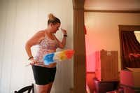 <p>Margaret Davis, who has lost more than 100 pounds since last year, dances while cleaning her Greenville home.</p>(Rose Baca/Staff Photographer)