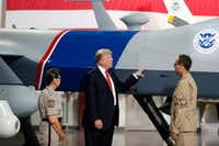 President Donald Trump touches an unmanned aerial vehicle during a tour of U.S. Customs and Border Protection Border equipment at an airport hangar at Marine Corps Air Station Yuma on Tuesday.(Alex Brandon/The Associated Press)