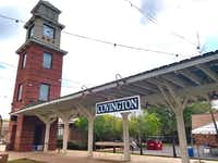 The Covington, La., clock tower and train station replica mark the trailhead for the 31-mile Tammany Trace through Tammany Parish. Covington is a relatively unknown foodie haven just across Lake Pontchartrain from New Orleans. (Helen Anders)