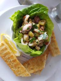 Olive-studded ceviche arrives in a lettuce shell at Del Porto Ristorante, a top-flight Italian restaurant in Covington, La., across Lake Pontchartrain from New Orleans. (Helen Anders)