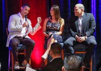 "Former Texas Rangers player Michael Young (left) recalled his first baseball encounter with Ivan ""Pudge"" Rodriguez (right) as moderator Emily Jones listens. They were one of two panel discussions at the Legends and Leaders event Aug. 22 at Globe Life Park in Arlington.(Ron Baselice/Staff Photographer)"