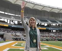 Baylor's new president, Linda Livingstone, is making some smart staffing changes. Above, she waves to the fans as she was introduced during the first half of the football team's spring Green and Gold game in April.(Jerry Larson/The Associated Press)
