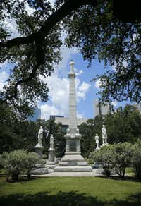 "The Confederate War Memorial honors Confederate soldiers who died in the Civil War at Pioneer Park Cemetery in downtown Dallas. A statue of a Confederate solider stands on top, facing the south. At the monument's base are four more statues, of Confederate President Jefferson Davis, Gen. Robert E. Lee, Gen. Thomas ""Stonewall"" Jackson, and Gen. Albert Sidney Johnston.(Tom Fox/Staff Photographer)"