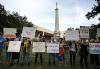 Protesters lining the fence surrounding the Confederate War Memorial in Pioneer Park chanted for officials to take it down before anti-white-supremacy rally at City Hall in downtown Dallas on Saturday.(Tom Fox/Staff Photographer)