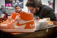 "<p><span style=""font-size: 1em; background-color: transparent;"">Jake Danklefs, right, works in his home studio in San Antonio with Dank & Co. employee Phil Macias, left. In the foreground are one pair of custom Whataburger sneakers Danklefs designed for the Texas burger company's #WhataThoseContest.</span></p>(Official/Whataburger)"