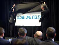 Texas Rangers Executive Vice President and Chief Revenue and Marketing Officer Joe Januszewski (left) and Globe Life Direct Response President and CEO Bill Leavell unveil the new name of the air-conditioned ballpark during a news conference at Globe Life Park in Arlington on Thursday.(Tom Fox/Staff Photographer)