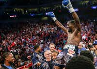 """Terence """"Bud"""" Crawford celebrates his win by knockout against Julius Indongo in the third round of a junior welterweight world title unification bout in Lincoln, Neb., on Aug. 19. Undefeated Crawford now holds the WBO, WBC, IBF and WBA 140 pound world titles. It was only the second fight in the four-belt era in which all four titles were on the line. (The Associated Press)"""