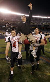 Texas Tech head coach Mike Leach is carried by Clay McGuire and Cody Campbell (right) after their victory against the University of California in the 2004 Holiday Bowl at San Diego's Qualcomm Stadium. (File Photo/Staff )