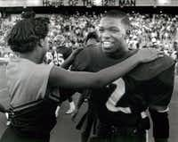 1988: Gary Edwards is congratulated by a cheerleader after a playoff game. Carter won 31-7, with Edwards scoring a touchdown and intercepting a pass.(Evans Cagelage/File Photo)