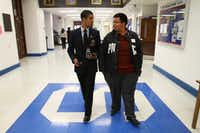 "In 2011, Adan Gonzalez, then class president of Adamson High School, patrolled the school as ""principal for the day."" With him is his friend Luis Retta. (File Photo/The Dallas Morning News)"