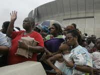 Dianne Wallace, left,  Alexis Fisher, 14,  Dejon Fisher, 8, and her mother Cavel Fisher Clay, 33, got a little unnerved as they waited in a hostile line at the New Orleans Superdome to get onto busses to the Houston Superdome on Thursday, September, 01, 2005, days after Hurricane Katrina flooded New Orleans.(MICHAEL AINSWORTH/Staff Photographer)