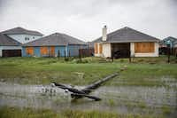 A power line was knocked down during Hurricane Harvey near boarded up homes in Rockport. (Tamir Kalifa/The New York Times)