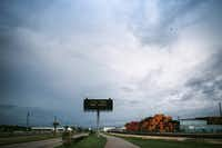 Roadside signs warned drivers of Hurricane Harvey's approach near the Houston Ship Channel. (Alyssa Schukar/The New York Times)
