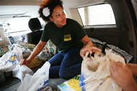 Alyce Mark, of Christian Chapel Temple of Faith, helps to unload donations at a drop off location of Trusted World donations for Hurricane Harvey relief in Dallas on Sunday.(Andy Jacobsohn/Staff Photographer)