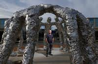 Artist Tom Friedman stood inside the creation he calls <i>Huddle</i>at The Star in Frisco on Sunday, Aug. 27. (Vernon Bryant/Staff Photographer)