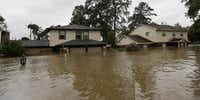 Floodwaters from Harvey surrounded homes Monday in Spring.(David J. Phillip/The Associated Press)