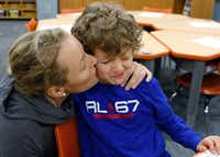 Christina Benedetti gives a goodbye kiss her son, Sebastian Benedetti, 7, as she leaves him at University Park Elementary. (David Woo/Staff Photographer)