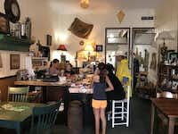 <p>Schulenburg residents gather at the counter of The Shop Downtown, which reopened Monday after a three-day deluge from Harvey finally let up.</p>(Charlie Scudder/Staff)