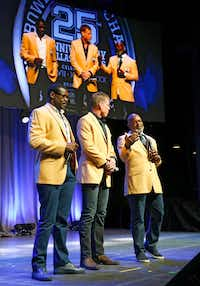 "Dinner with ""The Triplets"" — Michael Irvin, Troy Aikman and Emmitt Smith — will be one of the prizes. (Tom Fox/Staff Photographer)"