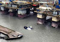 The Signet Enterprise sinks as helicopter air crews launched to assist the people in distress aboard the vessel near Port Aransas. (U.S. Coast Guard)