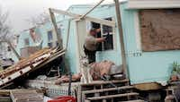 An inspector climbed through a window to check a home damaged by Hurricane Harvey on Sunday in Rockport. (Eric Gay/The Associated Press)