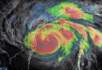 This blended visible/infrared image of Hurricane Harvey from the National Oceanic and Atmospheric Administration shows the storm's eye as it neared landfall off the coast of Texas on Friday.(Agence France-Presse)