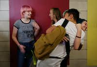 Miriam Priesman (left) and Mila Fisher, both sophomore students, talk in the hallway while two students embrace prior to the first bell on Monday at Booker T. Washington High School for the Performing and Visual Arts in the Arts District of Dallas.(Andy Jacobsohn/Staff Photographer)