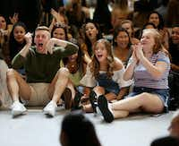 Dance students (from left) Luke Qualls, Kennedy Huff and Shelby Flowers, all seniors, cheer for an announcement during the first dance conservatory homeroom.(Andy Jacobsohn/Staff Photographer)