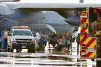 Evacuees from Hurricane Harvey arrived Dallas Love Field on a military aircraft on Monday, August 28, 2017. (David Woo/Staff Photographer)