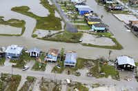 This aerial photo shows damaged homes in the wake of Hurricane Harvey, Monday, Aug. 28, 2017, in Corpus Christi, Texas. Harvey hit the coast as a Category 4 hurricane. (Gabe Hernandez/Corpus Christi Caller-Times via AP)