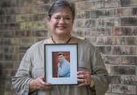 Hilda Brewer holds a portrait of her son Matthew Brewer, a freshman caught in Harvey at Rice University in Houston. Matthew weathered Harvey unharmed and safe on the Rice campus.(Robert W. Hart/Special Contributor)
