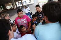 Luis Banda (far right), 12, an evacuee from Dickinson, Texas, speaks to the media alongside his family after arriving at the mega-shelter outside the Kay Bailey Hutchison Convention Center in Dallas on Tuesday, Aug. 29, 2017.(Rose Baca/Staff Photographer)