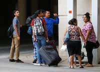 Evacuees from South Texas arrive at the mega-shelter outside the Kay Bailey Hutchison Convention Center in Dallas on Tuesday, Aug. 29, 2017.(Rose Baca/Staff Photographer)