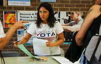 Liz Magallanes, D-FW coordinator of the nonprofit Mi Familia Vota, encourages students to register to vote at North Lake College in Irving. Magallanes, a Mexican immigrant, is a DACA beneficiary.&nbsp;(Ron Baselice/The Dallas Morning News<div><br></div><div><br></div><div><br></div><div><br></div><div><br></div>)