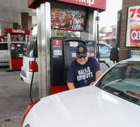 Rudy Garcia Sr. filled his car at a QuikTrip on Zang Boulevard in Dallas on Aug. 30.(Ron Baselice/Staff Photographer)