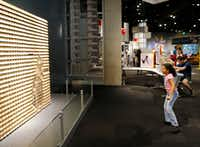 Sylvia Rodriguez, 9, of Spring plays with an interactive exhibit at the Perot Museum of Nature and Science in Dallas. (Vernon Bryant/Staff Photographer)
