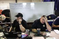 From left, Mark Koenig, a lieutenant with the Texas Department of Public Safety, and Chad Shaw, a deputy chief with the Harris County Fire Department, coordinate rescue operations in Houston. (Tamil Kalifa/The New York Times)