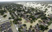 Water from Addicks Reservoir flows into neighborhoods as floodwaters from Tropical Storm Harvey rise Tuesday, Aug. 29, 2017, in Houston. (AP Photo/David J. Phillip)(David J. Phillip/AP)