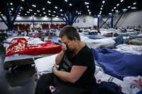"Mary Colson wipes away tears as she sits on a cot at the George R. Brown Convention Center where nearly 10,000 people are taking shelter after Tropical Storm Harvey Wednesday, Aug. 30, 2017 in Houston. ""I just don't know where I'm going to go,"" Colson said. ""I'm just so uncertain."" (Michael Ciaglo/Houston Chronicle)"