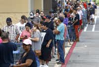 A long line stretched across the front of the Walmart on Hwy. 35 in Pearland, Texas, Wednesday, August 30, 2017, as they opened for the first time since Hurricane Harvey. Hundreds of people showed up to get groceries and supplies. (Tom Fox/Staff Photographer)