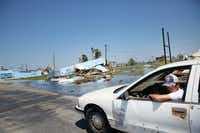 A man drives down South Austin Street in downtown Rockport, Texas on Wednesday, Aug. 30, 2017. The coastal region suffered severe damage after Hurricane Harvey hit the area on Aug. 26, 2017.(Staff Photographer/Rose Baca)