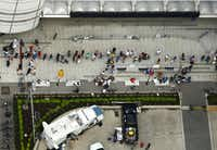 People line up outside the George R. Brown Convention Center, site of the Hurricane Harvey shelter in downtown Houston, Texas, Wednesday, August 30, 2017.(Tom Fox/The Dallas Morning News)